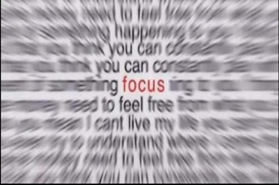 "Image of blurred words surrounding the word ""focus"" which alone is in focus."